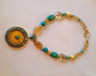 Necklace with round lemon jade Tibetan pendant with brass and turquoise