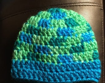 Blue and green crocheted baby hat