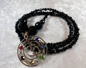 "Pearl Necklace pendant ""OM"", faceted glass beads, black, handmade"