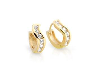 Huggie earrings. Gold huggie earrings. Silver huggie earrings. Cz diamond huggies. Small hoop earrings. Hoop earrings. Small huggies.