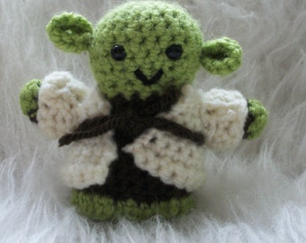 Crocheted little Yoda from Star Wars for the fans. Musthave in you collection. Can be used as decoration or as a toy.