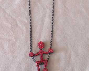 Red rhinestone man on swing necklace