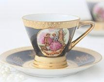 Set of Two Vintage Black and Caramel Porcelain  Demitasse Cup and Saucers, Fragonard Scene
