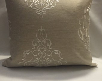 Creamy beige tan pillow with with decor pillow