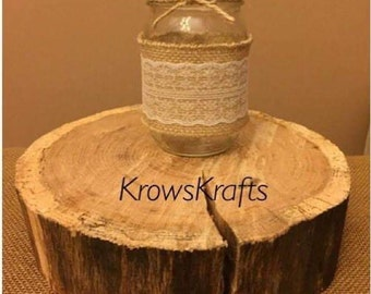 Mason jar hand wrapped in burlap and lace.