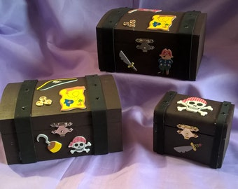 set of 3 pirate chests suitable for all little pirates,set of chests decorated with pirate themed decals a name can be added if requested.