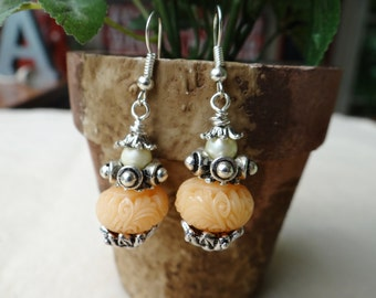 Earthy Style Carved Synthetic Coral Apricot Glass Earrings - ERU158