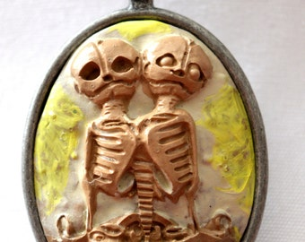 Conjoined twin skeletons handcrafted pendant neclace