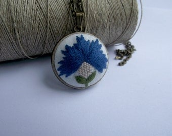 Embroidered pendant with cornflower