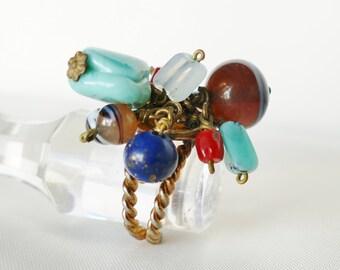 Ring Jeanne Peral vintage molten glass coral turquoise lapis lazuli pendants.