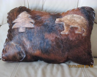 Leather pillow with hair on design