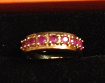 Sterling silver and ruby ring size 7.