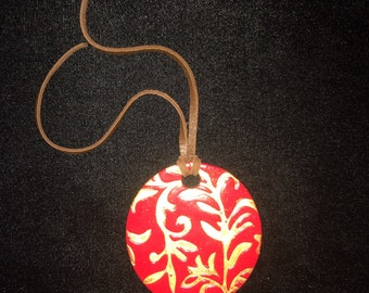 Red Circle Pendant with Gold Detailing