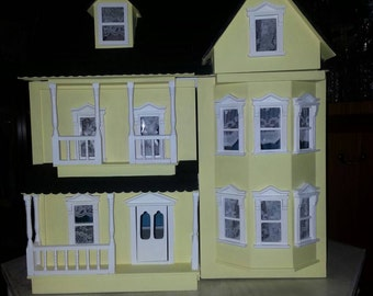 Beautiful painted decoupage dolls house.