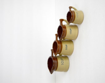 Vintage measuring cup set / stoneware pitcher style measuring cups / set of four