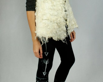 Felted vest made of natural wool with flockes