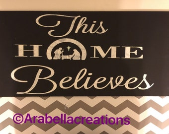 This home believes Christmas hand painted wood sign