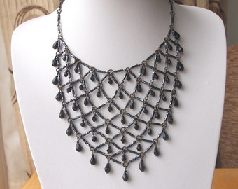 Stunning vintage black bead and antique bronze tone metal bib necklace