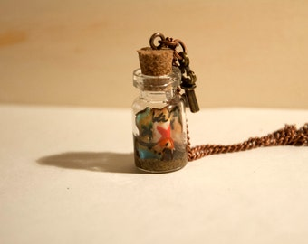 Handmade necklace with pendant-glass bottle containing a pirate treasure map