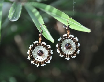 Earrings, round in shape in the colour bronze ecru