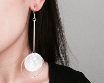 Oversized asymmetric hoop with pearl shells