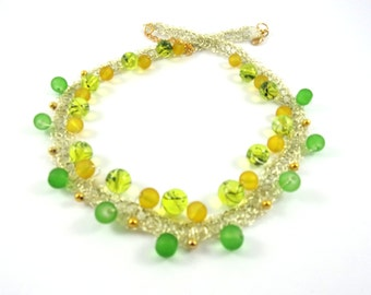 golden necklace with yelow , green pearls and golden pearls , golden wire .