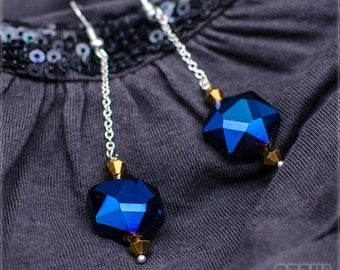 Blue glass crystals with small golden crystals and silver chain.