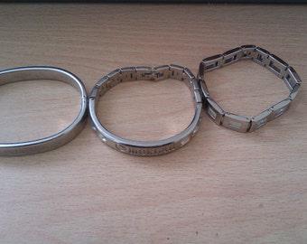 3 silver coloured bangle/bracelets