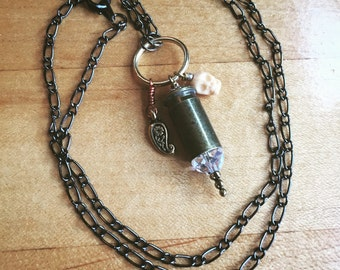 Mixed  Metal Charm Necklace With Carved Skull