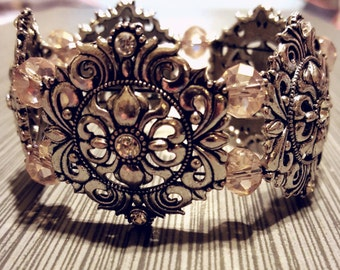 Price Reduced****Gorgeous Statement Medallion style with pale pink crystal beaded bracelet