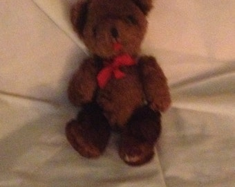 Little brown plush teddy bear with Red bow moveable arms