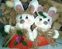 Pair of bunnies on carrot