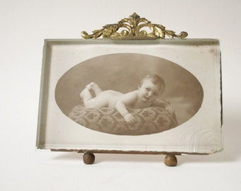 Antique French bevelled glass and brass frame.