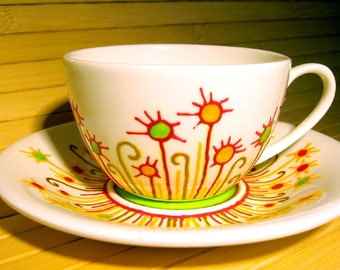 Porcelain tea/coffe cup and saucer hand painted with fantazy floral design