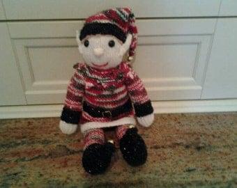 Lovingly handmade knitted elf on the shelf