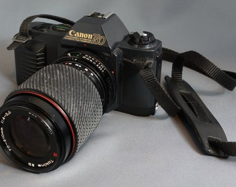 Canon T50 35mm camera with 70-210 Tokina zoom lens