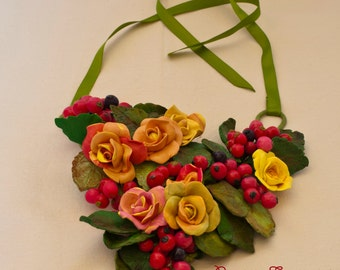 Yellow roses and red berries