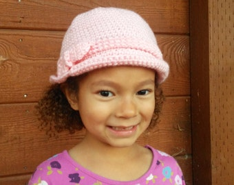 Pink child's hat with a pink bow