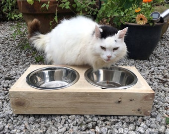 Raised pet feeding station made from reclaimed pallet timber - includes two stainless steel bowls. Perfect for messy pets at feeding time!