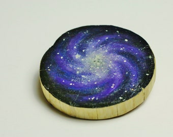 hand painted applewood slice with decorative spiral galaxy