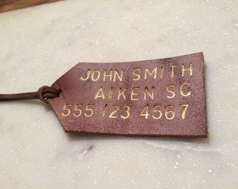 Hand-stamped, gold-lettered leather luggage tag