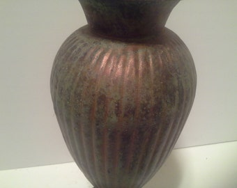 Metal vase with green patina