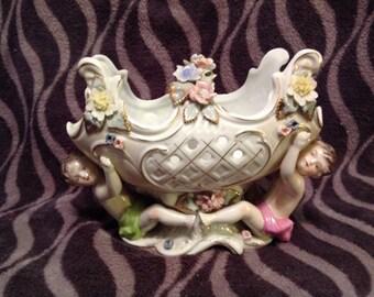 2 cherub basket shaped bowl