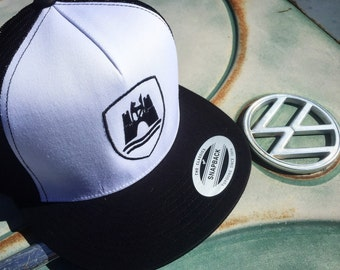 Wolfsburg Crest Snap Back Hat.  Structured front with embroidered Wolfsburg Crest design.  Mesh back with classic snap clasp.