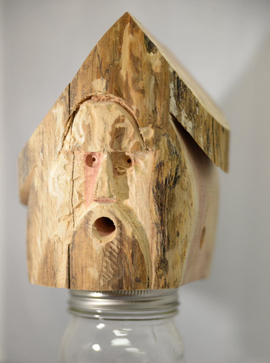 Artisan carved face carpenter bee trap