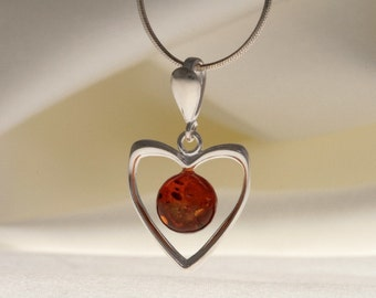 Baltic amber pendant. Cognac piece of Baltic amber in sterling silver setting.