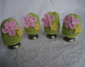 Pastel coloured, flower-motif, egg cosies (set of four)