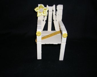 Chair made from wooden Clothes Pegs.