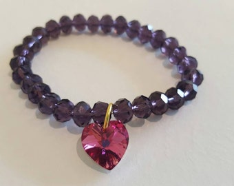 Purple bead bracelet with pink swarovski heart