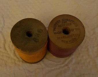 2 Vintage wooden spools of thread